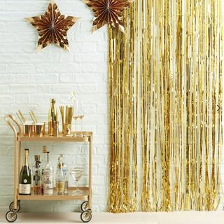 Ginger Ray for Paperchase hanging gold fringe curtain main image